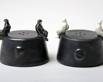 Ceramic Astronauts on Nose Cone Salt and Pepper Shakers