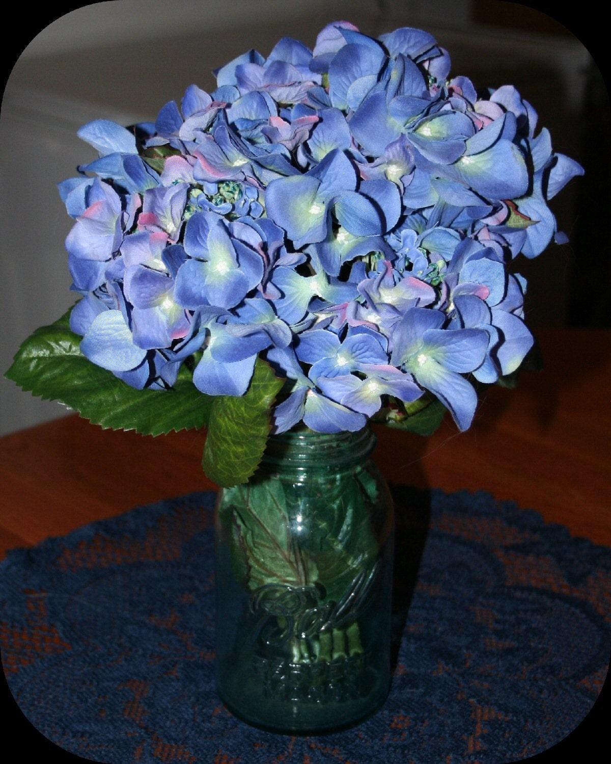 Silk hydrangea in vintage blue ball mason jar