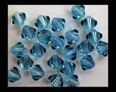 8mm Aquamarine Swarovski Bicone Beads - (12)