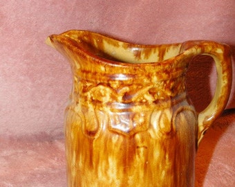 Bennington Pitcher with Molded Decoration 7 inches-