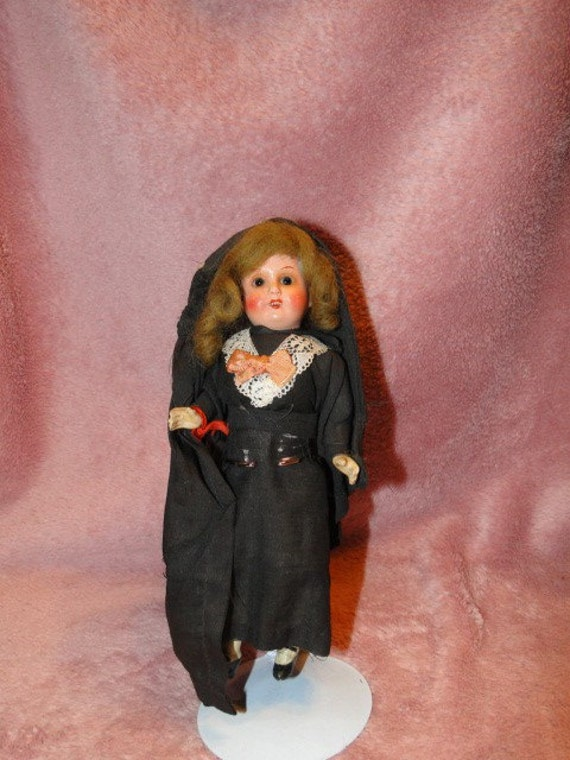 German Painted Bisque Doll 7 3/4 inches-