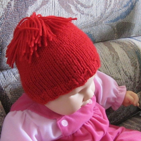Whitaker Knits red baby hat with tassle