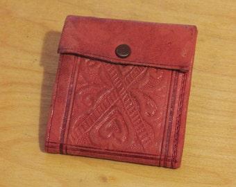 Vintage embossed leather wallet.
