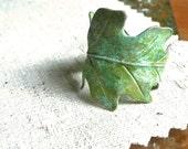 anitqued verdant green leaf ring
