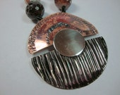 African Drums Faceted Agate Gunmetal and Copper Pendant Necklace