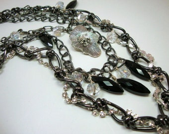 Statement Necklace, Multi Strand, Black Temptress Gunmetal Black Multi Chain Black and Clear Crystals Flower