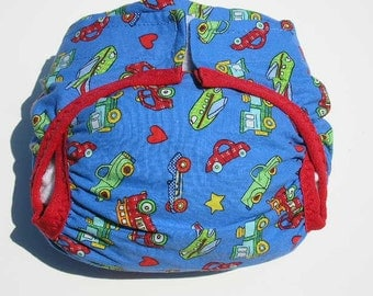 Diaper cover PUL lined Transportation printed on stadium blue ground trimmed in red size Medium