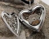 Unique Steampunk silver plated filigree heart locket with vintage watch parts and movement plate including moveable cogs