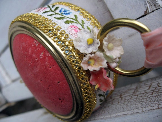 Vintage pincushion with pink velvet and fancy trim