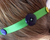 Green Hairband with Assorted Buttons