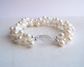 Twisted pearl bracelet teardrop shaped top drilled White freshwater pearl twisted bracelet multi strand with silver plated pearl clasp