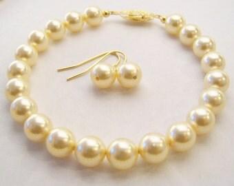 Swarovski Light gold pearl bracelet and earring set 8mm round pearls