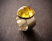 Lemon Burst ring - bright yellow Baltic Amber and sterling silver wide band bauble in a modern setting