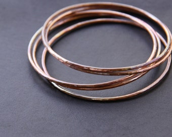 """Set of five hammered copper bracelets formed and heat treated for a unique and modern look and splash of fall colors - """"Desert Bangles"""""""