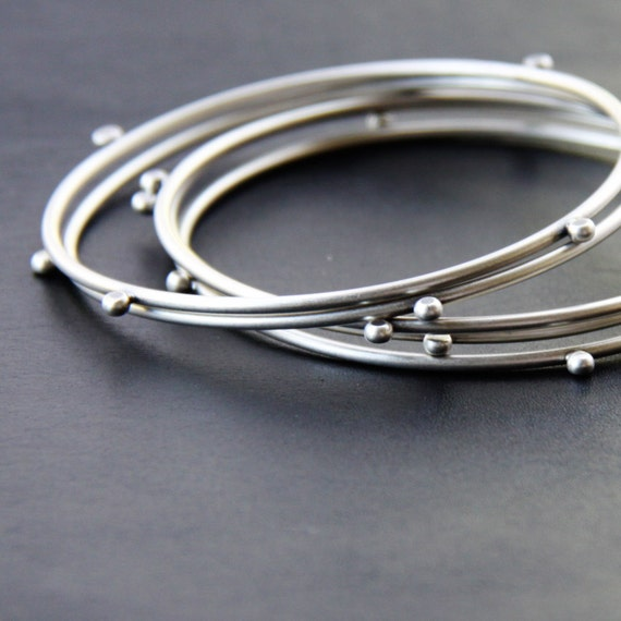 "ON SALE this week - Modern silver stacking bangles, set of 5 silver bracelets with 4 silver balls - ""Compass Bangles"""