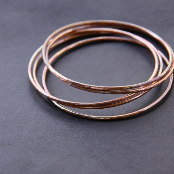 "Set of five hammered copper bracelets formed and heat treated for a unique and modern look and splash of fall colors - ""Desert Bangles"""