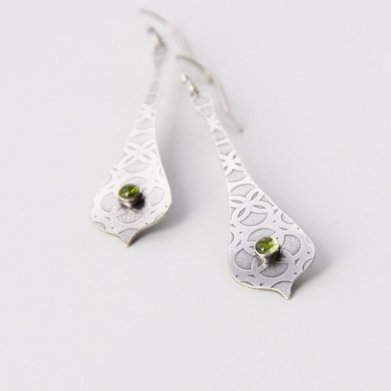 "Long silver earrings accented with gorgeous green Peridot cabochons bezel set on a unique curved form - ""Olivine Earrings"""