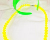 1980s NEON green hairband and yellow necklace