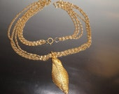 Vintage Triple Chain with Shell Like Pendant