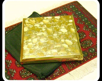 Vintage gorgeous goldtone powder compact with black fabric carrying case 1950s - Swiss AGME
