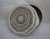 White seed beaded circular tin