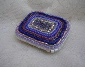 Blues pinks and purples small beaded tin