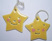 Two Porcelain Star  Decorations  2  3/4 x 2 3/4 inch x .25 thick