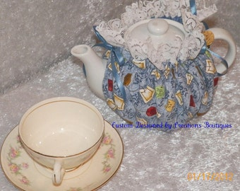 Teapot Cozy in Blue Background with Browns Yellows/Gold ETC. with Tea Names Tags and Tea Bags