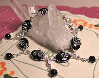Black Onyx ... silver swirls ... bracelet