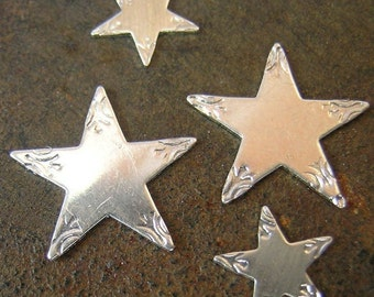 Sterling Silver Design Stars(2 - 5/8)and (2- 3/8'')