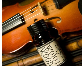 the wormwood - natural perfume oil - cologne oil in anise, sweet pea blossom and mint - in 1/6 oz amber bottle
