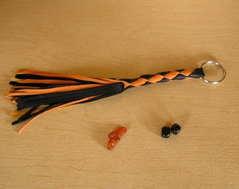 "Custom order for Katie Amren, 2 Whip Keychains, 5"" four braid leather Whip with 11"" fringe in Black and Orange"