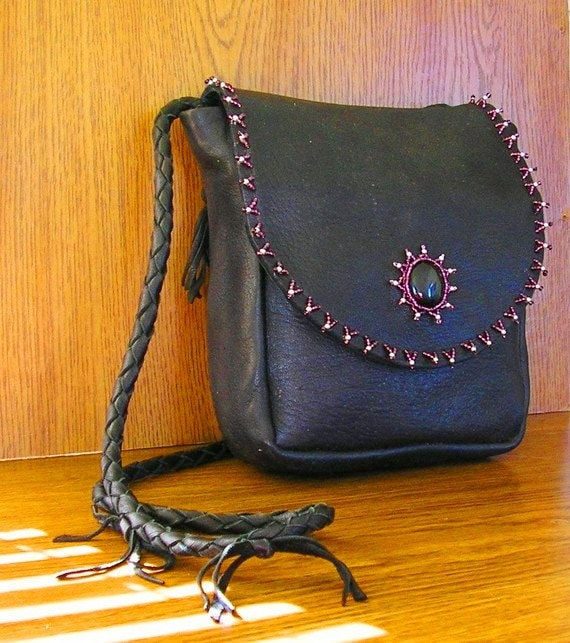 "Black deerskin leather purse with a black cabochon stone, silver and purple glass seed beads, it is  6"" x 7"" with a lariat strap"