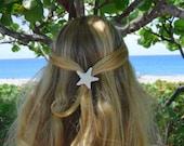 Small white knobby starfish barrette