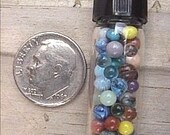 50 to 70 Miniature Glass Marbles by J. R. Hooper