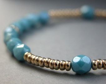 Gold bead and blue crystal bracelet
