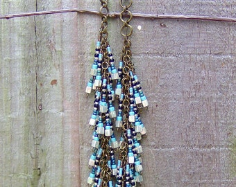 Old world elegant glass beads drape beautifully from a hand fabricated chainmaille design generating pure Bohemian chic with a Tribal twist