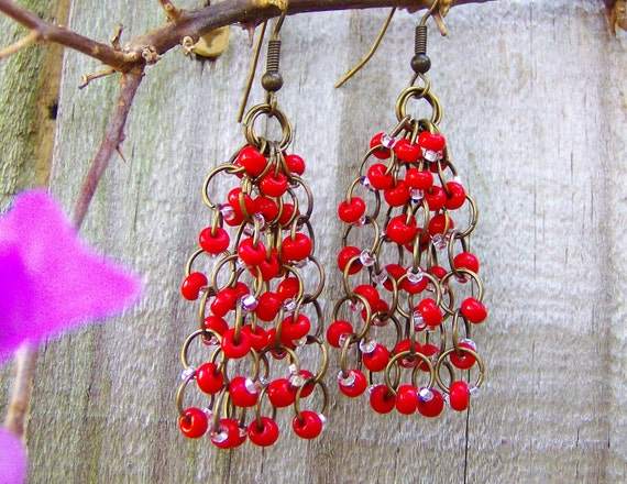 Elegant Bohemian plump lipstick red beads drape beautifully from hand fabricated chain generating exciting inspiration with a tribal twist..