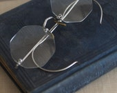 caulfield collection. vintage silver specs