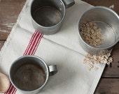 vintage tin measuring cups