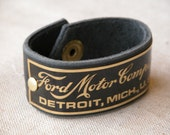 Black leather cuff with vintage brass 'Ford Motor Co.' plate