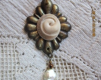 Fossile Shell on Old Brass Escutcheon Necklace