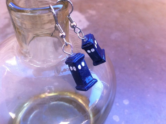 Police box earrings hung on polished silver color wire