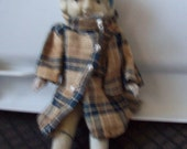 Antique Bisque Doll, Japan made. all four limbs move. original coat with her.