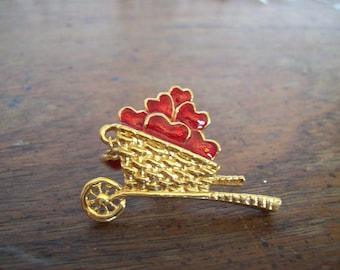 Vintage Avon wheelbarrow with Valintine hearts brooch