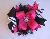 Large hot pink and zebra boutique hair bow