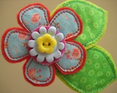 Flower brooch, fabric and buttons