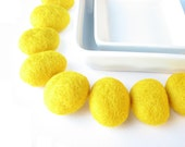 8 flat felted wool pebbles / beads  (yellow). Perfect for room decoration.