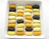32 felted wool pebbles (dark gray and yellow shades)