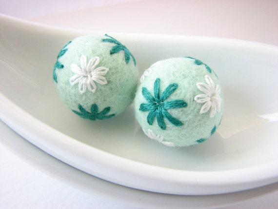 Set of round mint felted wool beads with floral ornaments (white, green)